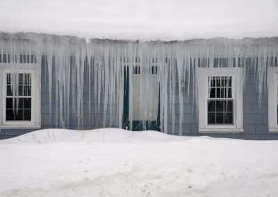 Icicles haging from ice dam roof in New England
